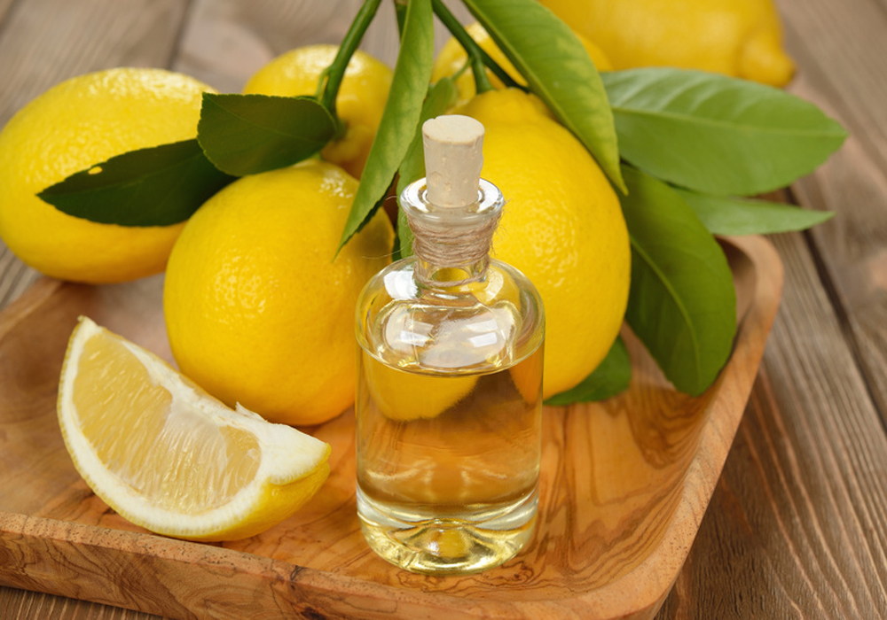 Lemon essential oil on a brown background